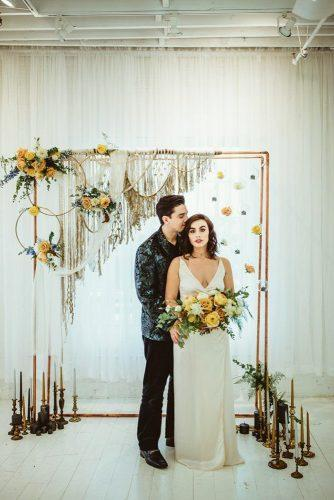wedding colors 2019 bohebian altar with mustard flowers and macrame brandi potter photography