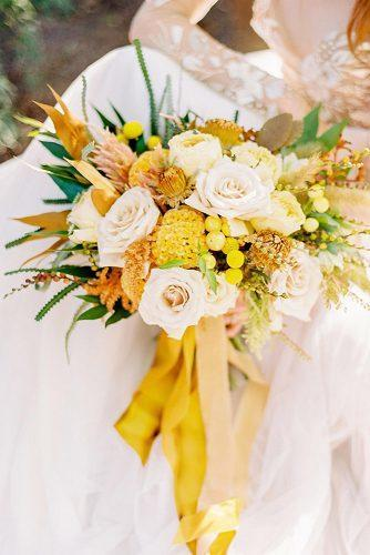 wedding colors 2019 mustard yellow flowers in bridal bouquet with ribbons love by serena