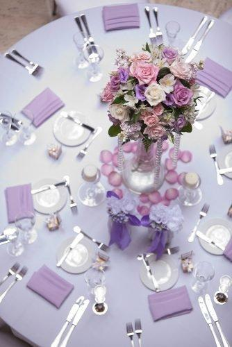 wedding colors 2019 lilac roses flowers in tall vase on round table miller + miller photography