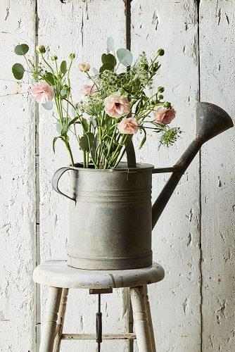 cute wedding ideas watering can filled with flowers