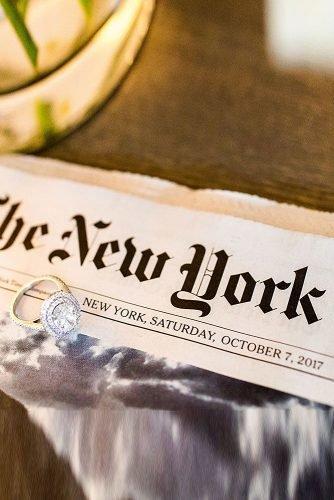 cute wedding ideas wedding rings on the newspaper
