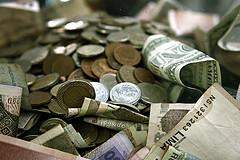 International Money Pile in Cash and Coins