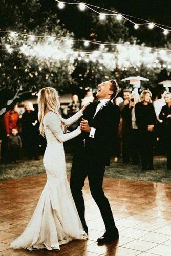first dance wedding shots outdoor light with sparkle alta moda