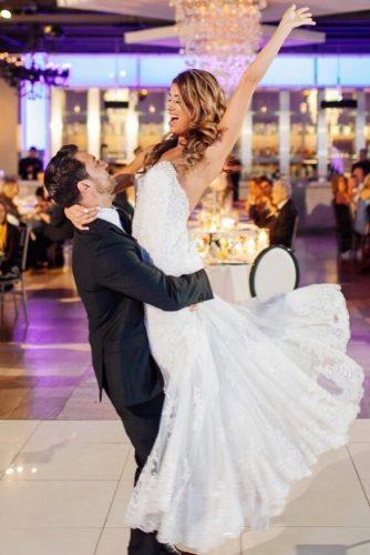 first dance wedding shots in grooms hands bride and groom carly goodrich via instagram