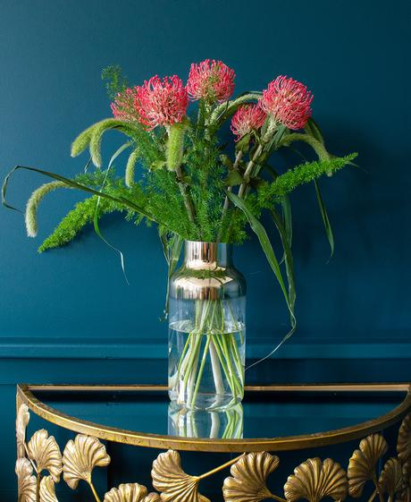 Tips for flower arranging - mix in artificial flowers like these pink protea stems