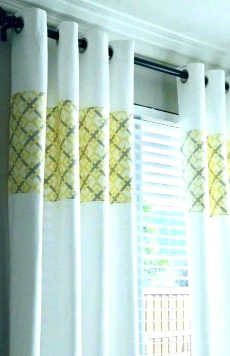 yellow window shades blinds and gray curtains