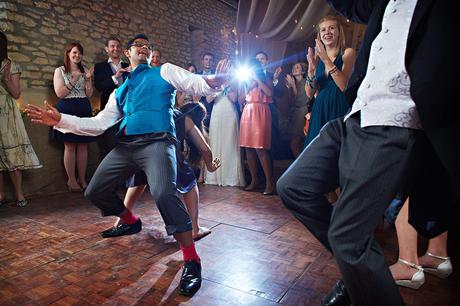 the groom dances with his guests