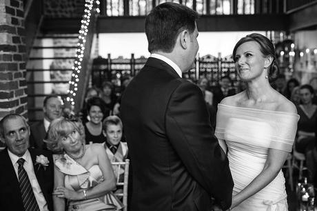 a loving look during a chaucer barn wedding