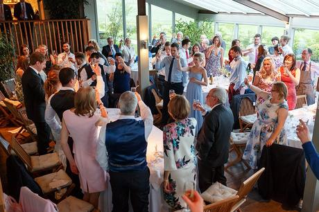 wedding guests applaud the speeches