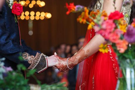 holding hands at a sussex barn wedding ceremony