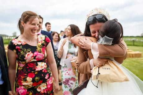 hugs for the bride from a guest