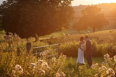 bride and groom in the sunshine at gaynes park