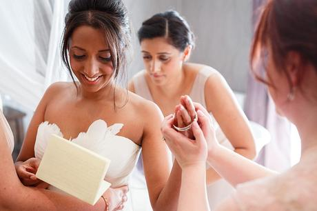a bride reads a letter from the groom