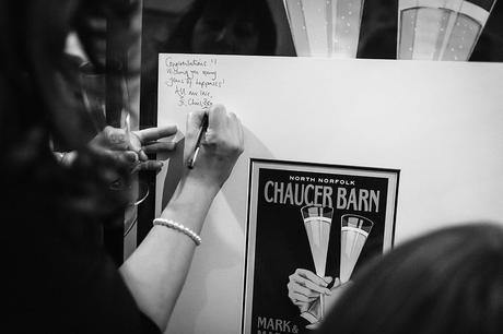 a guest signs the picture frame at chaucer barn