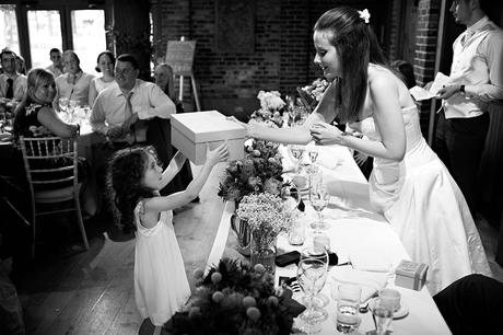 the bride gives a flowergirl a gift