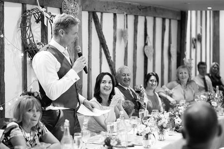 the bride laughs at the grooms speech