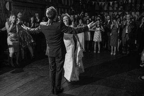 bride and groom come together for the first dance at gate street barn