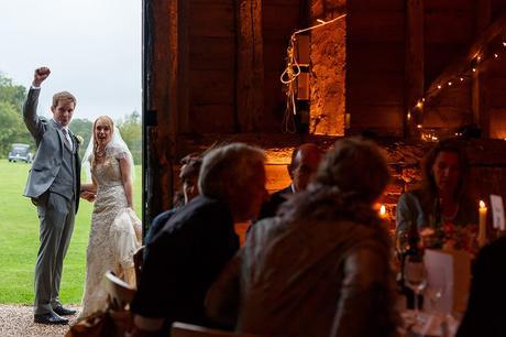 bride and groom look in their suffolk barn wedding reception