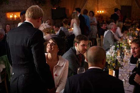 guests chat during a barn wedding