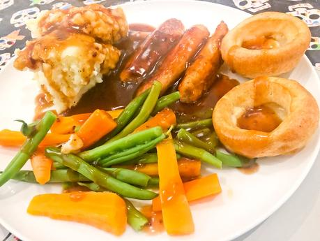 Meat-free sausages, mash and veg
