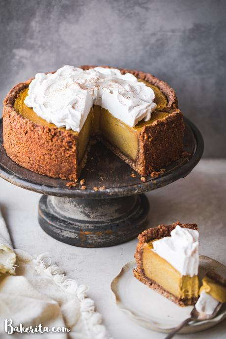 This Baked Vegan Pumpkin Cheesecake will wow you with its rich texture, spices, and graham cracker style crust. It's the perfect vegan Thanksgiving dessert.