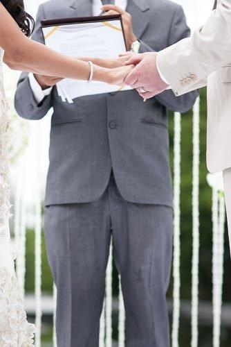 modern wedding vows bride and groom exchanging vows