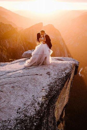 non traditional wedding songs newlyweds elope kissing at the mountain