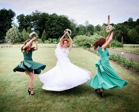 upbeat wedding songs bride dancing with bridesmaids