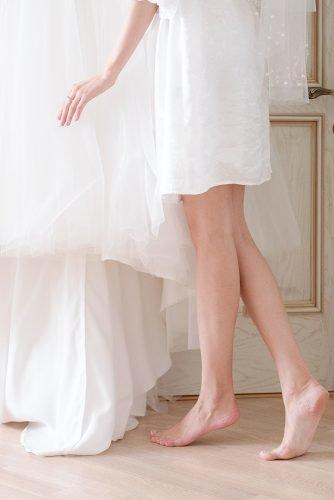 average price of wedding dress bride with her wedding dress