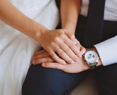 funny wedding readings newlyweds holding hands