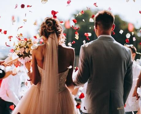 average price of a wedding average wedding cost newlyweds exit to wedding guests