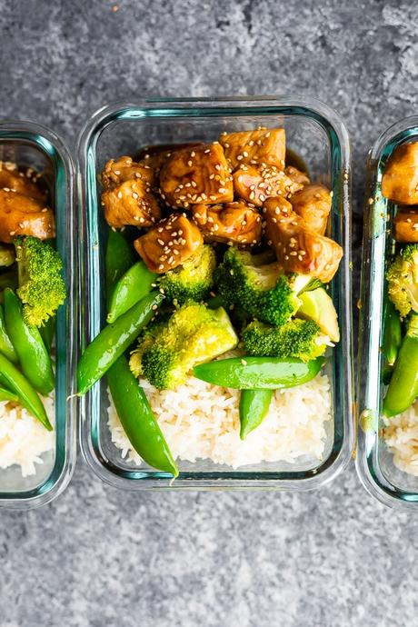 overhead shot of Honey Sesame Chicken Lunch Bowls in meal prep container