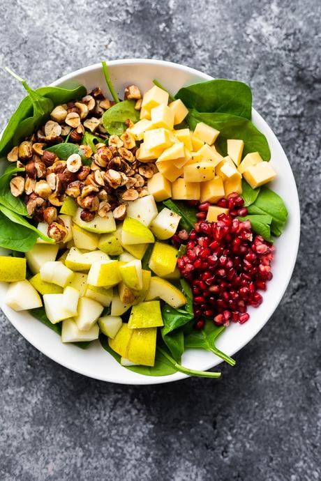 overhead view of pear salad in white bowl