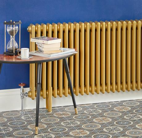 Milano Windsor gold radiator next to a coffee table