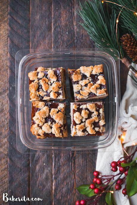 TheseGluten-Free Vegan Jam Barsare made with a scrumptious oatmeal crumble crust that doubles as a crumb topping and a thick layer of jam in the middle. They're the perfect easy, vegan holiday dessert.