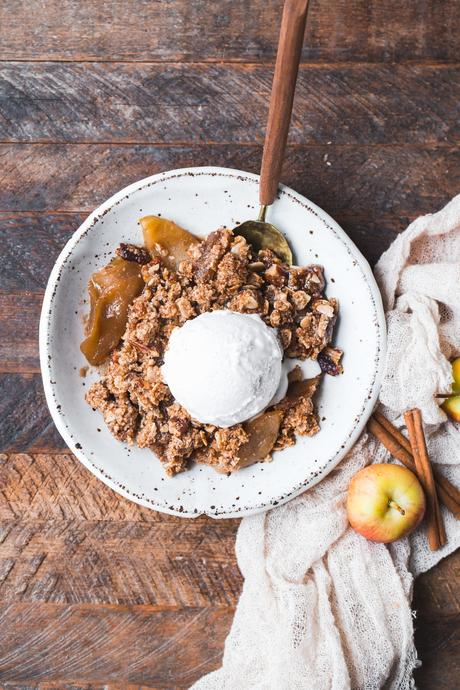 ThisGluten-Free Vegan Apple Crisp will make you want seconds! With a luscious caramel apple filling and oatmeal crumble topping, this vegan holiday dessert is irresistible.