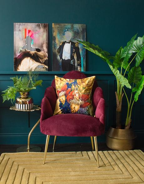 Cool, quirky prints. Moody, blue living room with unusual Duke and Duchess art prints.
