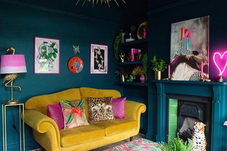 Eclectic, moody living room inspiration. Colourful, unusual wall art, paired with quirky animal homewares.