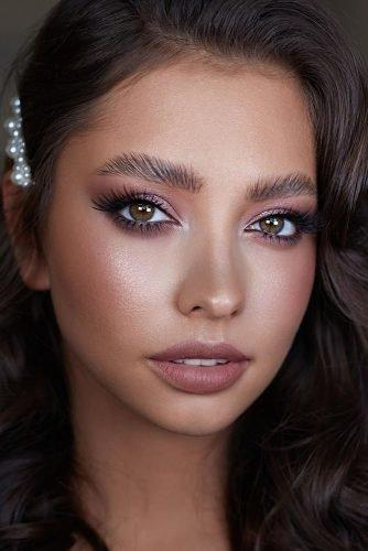 bridal makeup trends elegant shimmer eyes long lashes glow skin highlighter nude lips sofia_baburina