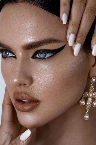 bridal makeup trends bold black arrows shine skin matte lips bold brows skintypesmag