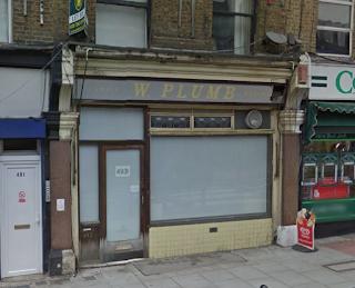 Plumbs the butcher, Hornsey Road, reveal of older sign