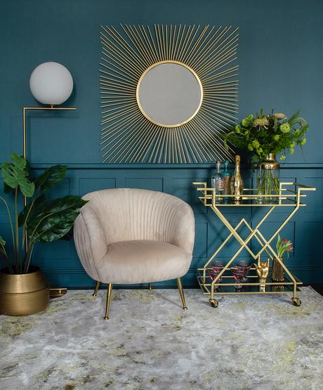 Glamorous living room with fabulous golden drinks trolley and square sunburst mirror