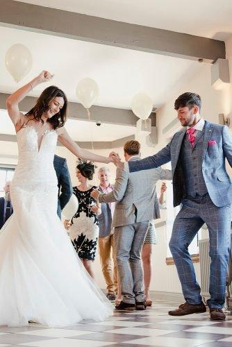 hip hop wedding songs newlyweds and guests dancing