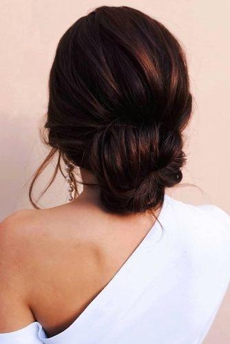 wedding hair trends brown swept modern textured chignon nastya_kopach