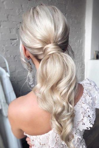 wedding hair trends elegant long hair blonde curly ponytail hair_vera