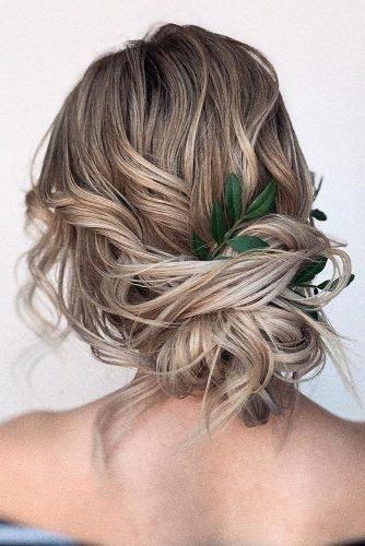 wedding hair trends curly messy textured updo with greenery olesya_zemskova
