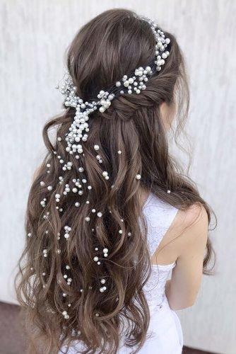 wedding hair trends half up half down with accessory loose pearls and black curls julia_alesionok