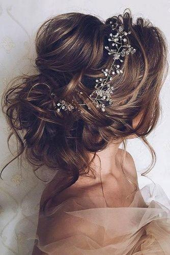 wedding hair trends textured airy wavy updo with crystal halo aster