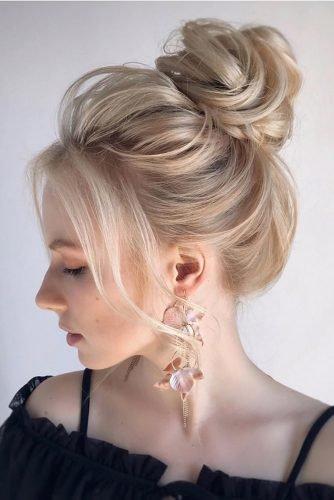 wedding hair trends elegant high bun textured blonde hair_vera