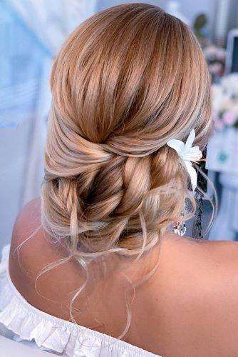 wedding hair trends blonde low updo with loose curls and white flowers lalasupdos
